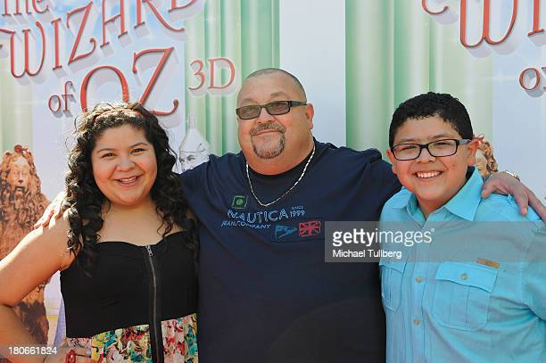 Actress Raini Rodriguez father Roy Rodriguez and actor Rico Rodriguez attend the world premiere of 'The Wizard Of Oz 3D' at the grand opening of the...