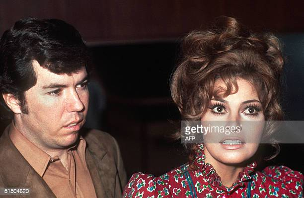 US actress Raquel Welch and her fiancT US producer Patrick Curtis address the press 14 January 1970 upon their landing at Paris Orly airport Welch...