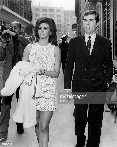 US actress Raquel Welch and her newwed husband US producer Patrick Curtis take a walk in Paris' streets 14 February 1967 They have married the same...