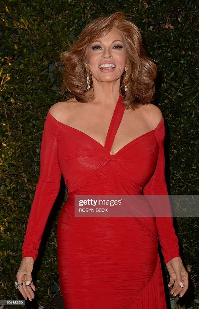 Actress Raquel Welch arrives for the 2013 Governors Awards, presented by the American Academy of Motion Picture Arts and Sciences (AMPAS), at the Grand Ballroom of the Hollywood and Highland Center in Hollywood, California, November 16, 2013. AFP PHOTO / Robyn Beck