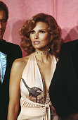 Actress Raquel Welch poses backstage after presenting ' Documentary Awards' with actor James Caan during the 46th Academy Awards at Dorothy Chandler...