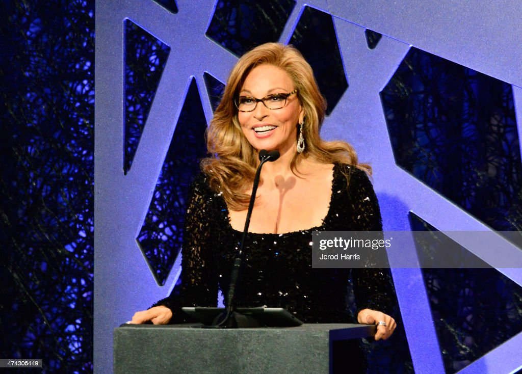 Actress <a gi-track='captionPersonalityLinkClicked' href=/galleries/search?phrase=Raquel+Welch&family=editorial&specificpeople=203311 ng-click='$event.stopPropagation()'>Raquel Welch</a> speaks onstage during the 16th Costume Designers Guild Awards with presenting sponsor Lacoste at The Beverly Hilton Hotel on February 22, 2014 in Beverly Hills, California.