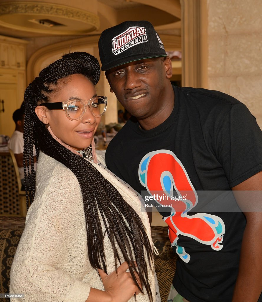 Actress <a gi-track='captionPersonalityLinkClicked' href=/galleries/search?phrase=Raven&family=editorial&specificpeople=201783 ng-click='$event.stopPropagation()'>Raven</a>-Symone and manager Chaka Zulu during Neuro Drinks At LudaDay Weekend Celebrity Pool Party on September 2, 2013 in Atlanta, Georgia.