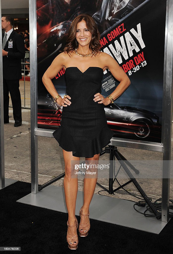 Actress <a gi-track='captionPersonalityLinkClicked' href=/galleries/search?phrase=Rebecca+Budig&family=editorial&specificpeople=206682 ng-click='$event.stopPropagation()'>Rebecca Budig</a> arrives at the 'Getaway' - Los Angeles Premiere at Regency Village Theatre on August 26, 2013 in Westwood, California.