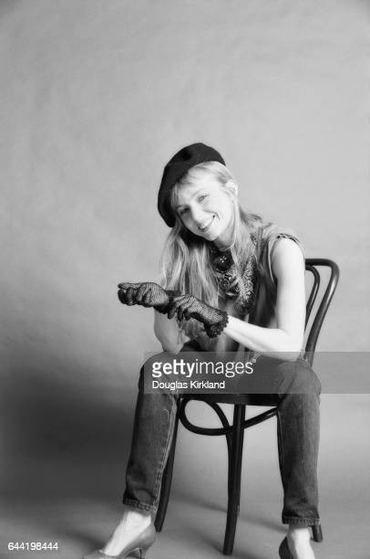 Actress Rebecca De Mornay wearing a beret and gloves and sitting on a chair in 1984 Rebecca De Mornay had just starred opposite Tom Cruise in the...