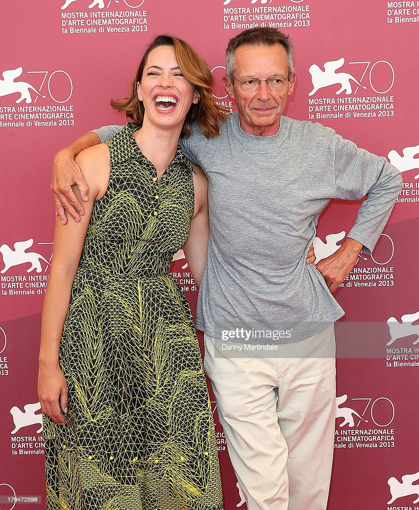 Actress <a gi-track='captionPersonalityLinkClicked' href=/galleries/search?phrase=Rebecca+Hall&family=editorial&specificpeople=778176 ng-click='$event.stopPropagation()'>Rebecca Hall</a> (L) and director <a gi-track='captionPersonalityLinkClicked' href=/galleries/search?phrase=Patrice+Leconte&family=editorial&specificpeople=224040 ng-click='$event.stopPropagation()'>Patrice Leconte</a> attend 'Une Promesse' Photocall during the 70th Venice International Film Festival at Palazzo del Casino on September 4, 2013 in Venice, Italy.
