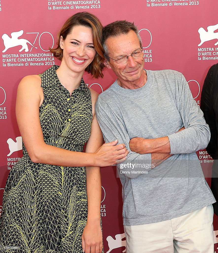 Actress <a gi-track='captionPersonalityLinkClicked' href=/galleries/search?phrase=Rebecca+Hall&family=editorial&specificpeople=778176 ng-click='$event.stopPropagation()'>Rebecca Hall</a> and director <a gi-track='captionPersonalityLinkClicked' href=/galleries/search?phrase=Patrice+Leconte&family=editorial&specificpeople=224040 ng-click='$event.stopPropagation()'>Patrice Leconte</a> attend 'Une Promesse' Photocall during the 70th Venice International Film Festival at Palazzo del Casino on September 4, 2013 in Venice, Italy.