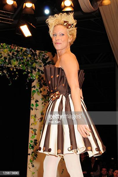 Actress Rebecca Hampton dressed by Victoire Finaz and Olivia Louvet attends the Salon Du Chocolat 2010 Opening Night at the Parc des Expositions...