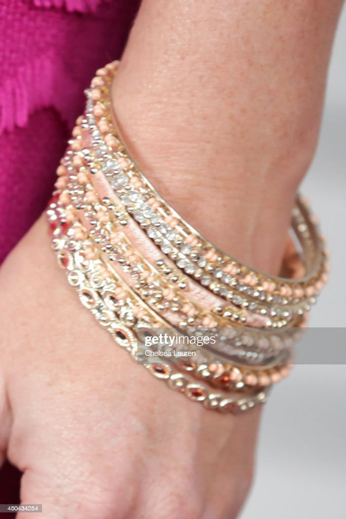 Actress Rebecca Mader (bracelet detail) arrives at Maxim Hot 100 at Pacific Design Center on June 10, 2014 in West Hollywood, California.