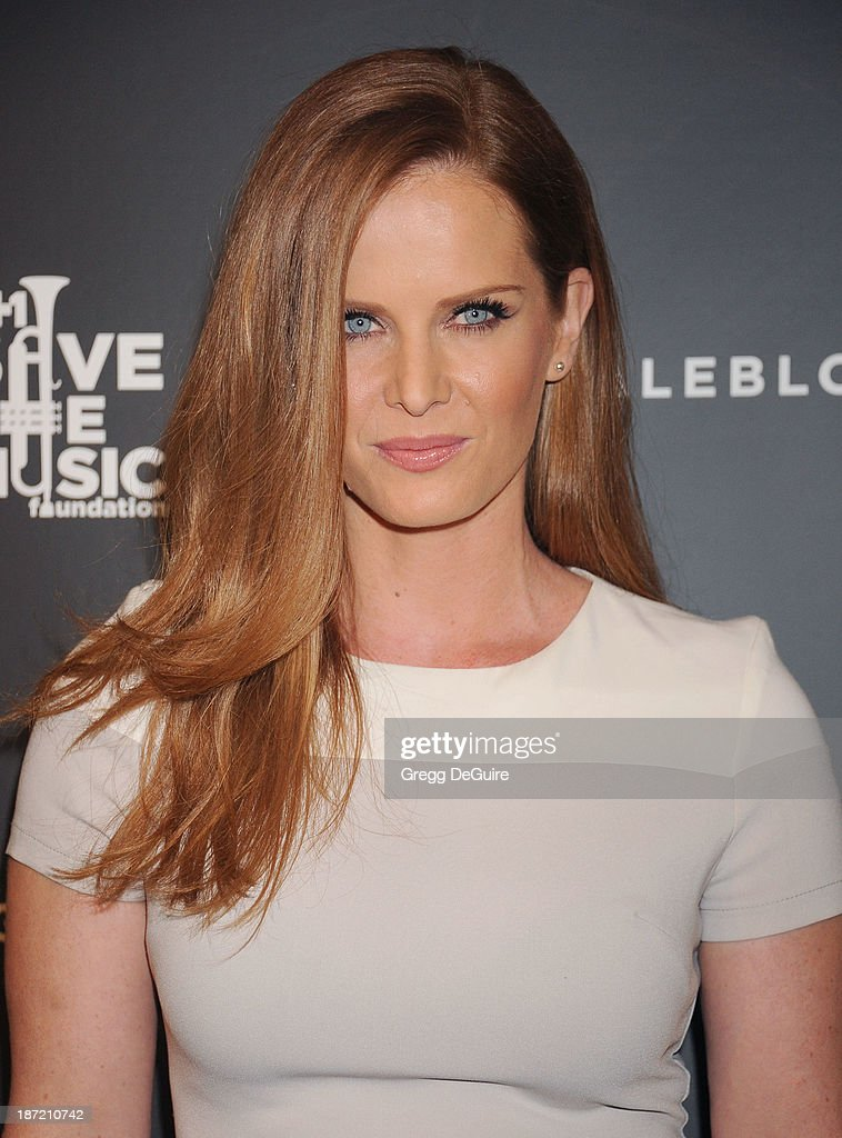 Actress <a gi-track='captionPersonalityLinkClicked' href=/galleries/search?phrase=Rebecca+Mader&family=editorial&specificpeople=540377 ng-click='$event.stopPropagation()'>Rebecca Mader</a> arrives at the Bloomingdale's Glendale Opening Gala Celebration with VH1 Save The Music Foundation at Bloomingdale's Glendale on November 6, 2013 in Glendale, California.