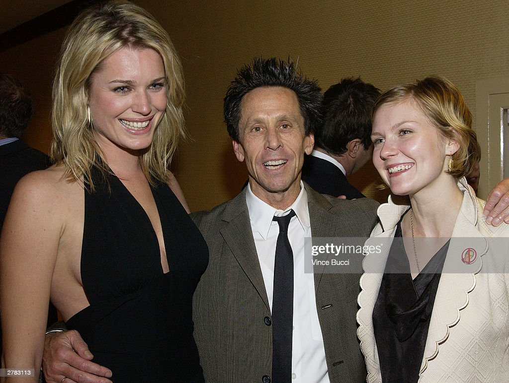 Actress Rebecca RomijnStamos producer Brian Grazer and actress Kirsten Dunst attend the first Annual Oceana Partners Awards Dinner December 3 2003 in...