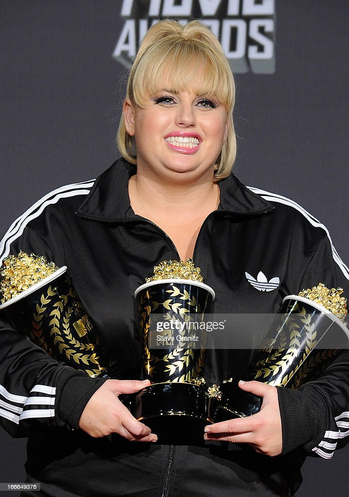 Actress Rebel Wilson poses in the press room during the 2013 MTV Movie Awards at Sony Pictures Studios on April 14, 2013 in Culver City, California.