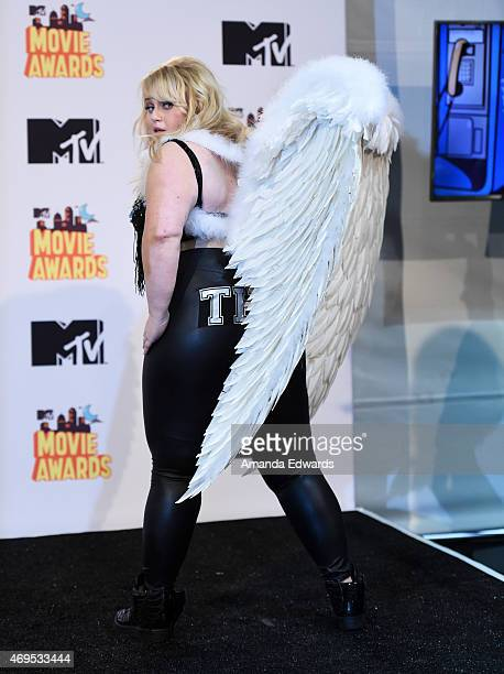 Actress Rebel Wilson poses in the press room during the 2015 MTV Movie Awards at the Nokia Theatre LA Live on April 12 2015 in Los Angeles California