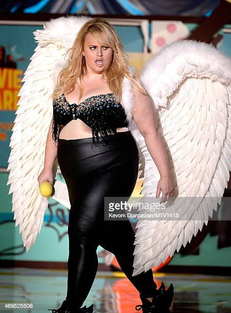 Actress Rebel Wilson speaks onstage during The 2015 MTV Movie Awards at Nokia Theatre LA Live on April 12 2015 in Los Angeles California