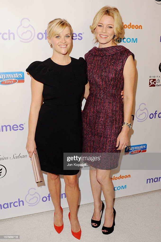 Actress Reese Witherspoon and actress Elizabeth Banks arrive at the March Of Dimes Celebration Of Babies Luncheon at Beverly Hills Hotel on December 7, 2012 in Beverly Hills, California.