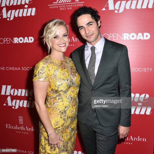 Actress Reese Witherspoon and Designer Zac Posen attend The Cinema Society with Elizabeth Arden Lindt Chocolate host a screening of Open Road Films'...