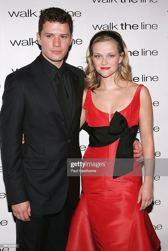 Actress Reese Witherspoon and her husband Ryan Phillippe attend the premiere of 'Walk The Line' at the Beacon Theater November 13 2005 in New York...
