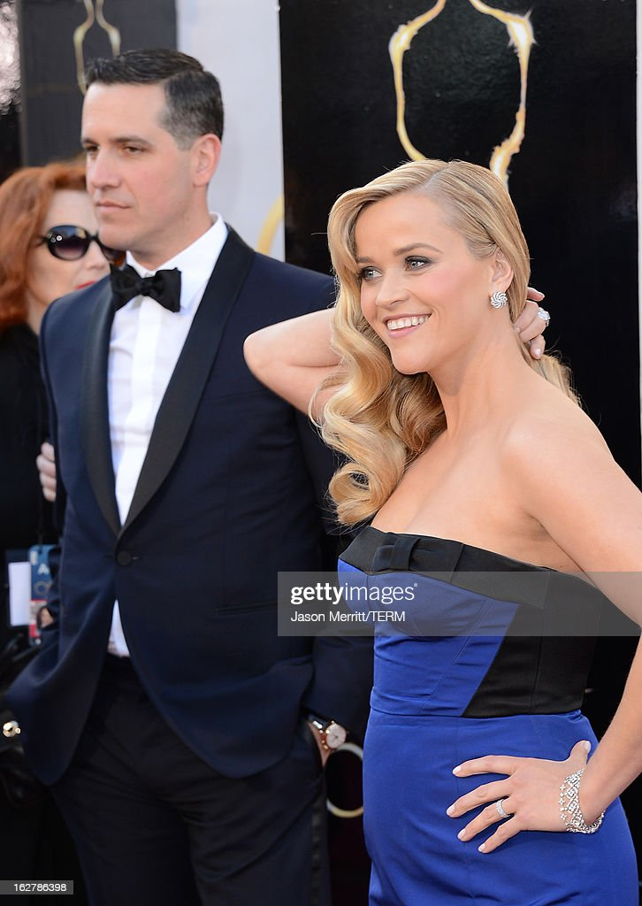 Actress Reese Witherspoon and husband Jim Toth arrive at the Oscars at Hollywood & Highland Center on February 24, 2013 in Hollywood, California.