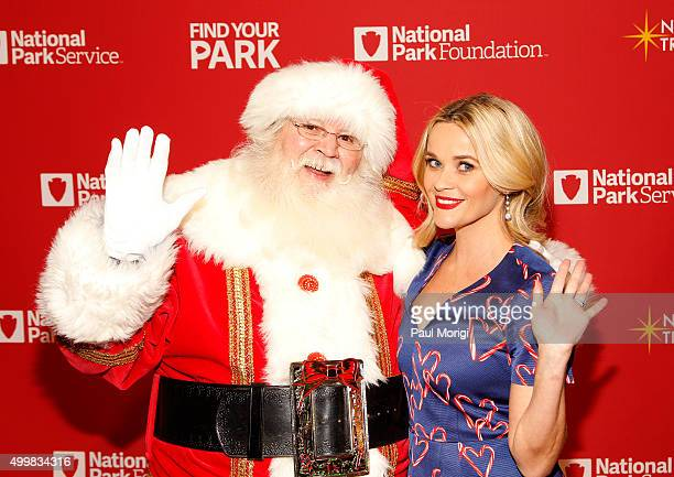 Actress Reese Witherspoon poses for a photo with Santa Claus at the 93rd Annual National Christmas Tree Lighting at The Ellipse on December 3 2015 in...