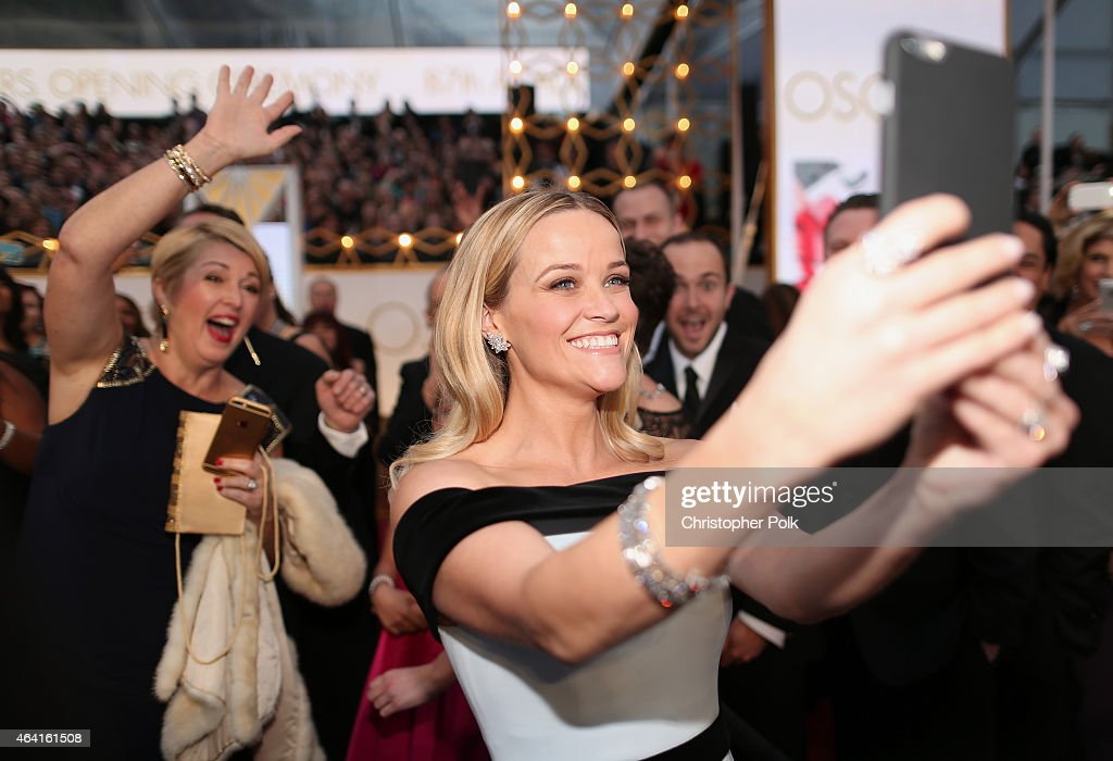 Actress <a gi-track='captionPersonalityLinkClicked' href=/galleries/search?phrase=Reese+Witherspoon&family=editorial&specificpeople=201577 ng-click='$event.stopPropagation()'>Reese Witherspoon</a> takes a selfie at the 87th Annual Academy Awards at Hollywood & Highland Center on February 22, 2015 in Hollywood, California.
