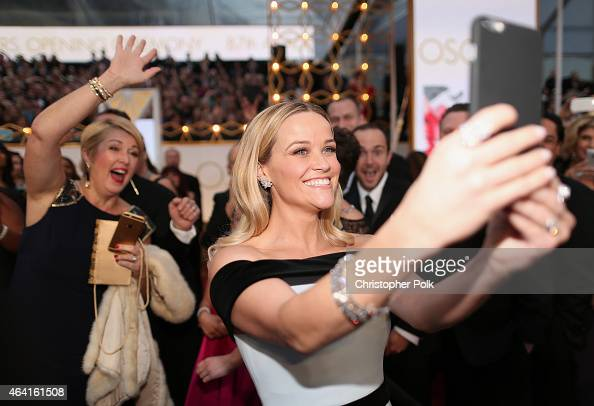 Actress Reese Witherspoon takes a selfie at the 87th Annual Academy Awards at Hollywood Highland Center on February 22 2015 in Hollywood California