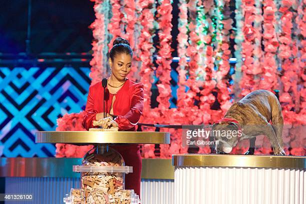 Actress Regina Hall and her dog Zeus serve as presenters at 'The World Dog Awards' at Barker Hangar on January 10 2015 in Santa Monica California