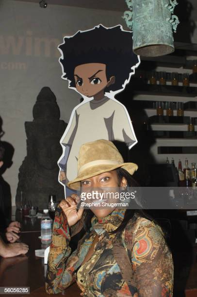 Actress Regina King poses with the cutout of the character she voices at the Los Angeles Launch Party For The TV Series 'The Boondocks' at Mood on...