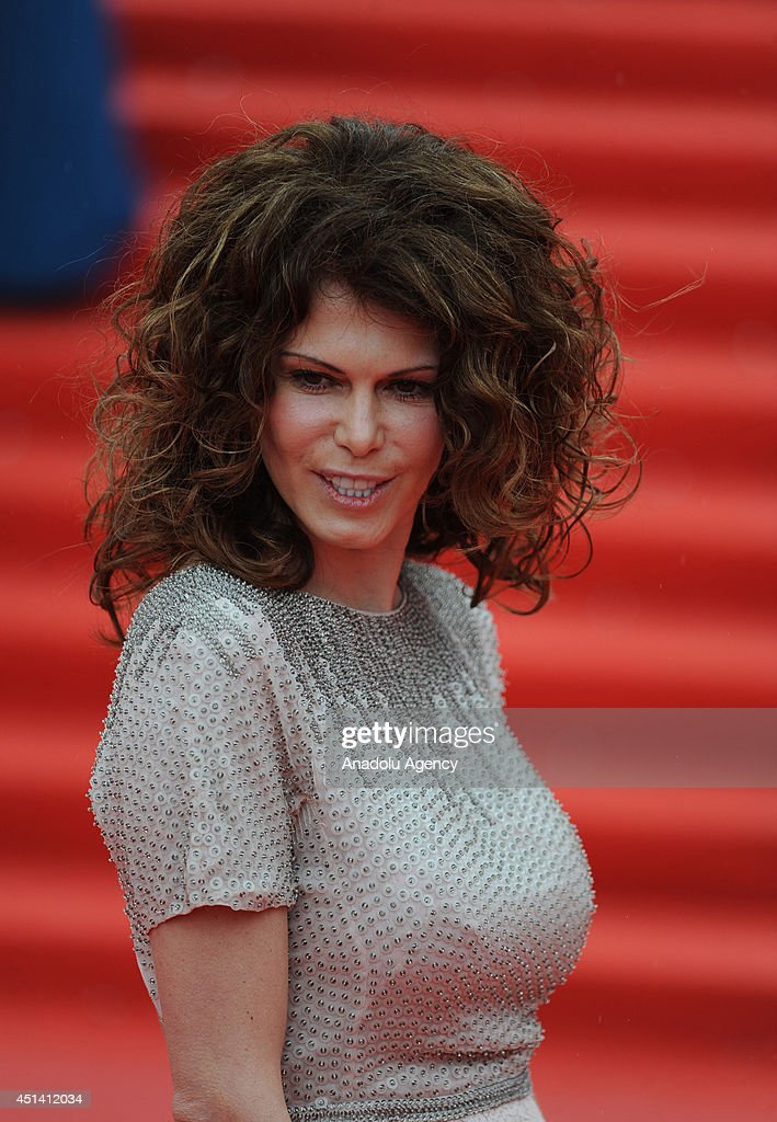 Actress Regina Myannik poses on the red carpet during the closing ceremony of the 36th Moscow International Film Festival in Moscow Russia on June 28...