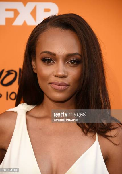 Actress Reign Edwards arrives at the premiere of FX's 'Snowfall' at The Theatre at Ace Hotel on June 26 2017 in Los Angeles California