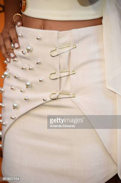 Actress Reign Edwards fashion detail arrives at the premiere of FX's 'Snowfall' at The Theatre at Ace Hotel on June 26 2017 in Los Angeles California
