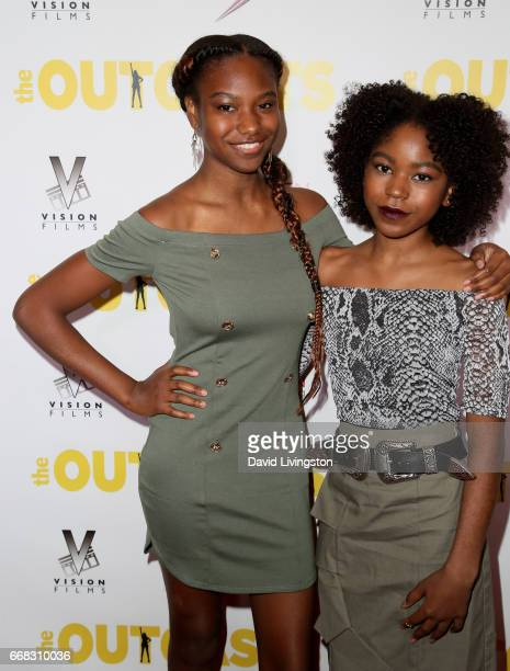 Actress Reiya Downs and Riele Downs attend the premiere of Swen Group's 'The Outcasts' at Landmark Regent on April 13 2017 in Los Angeles California