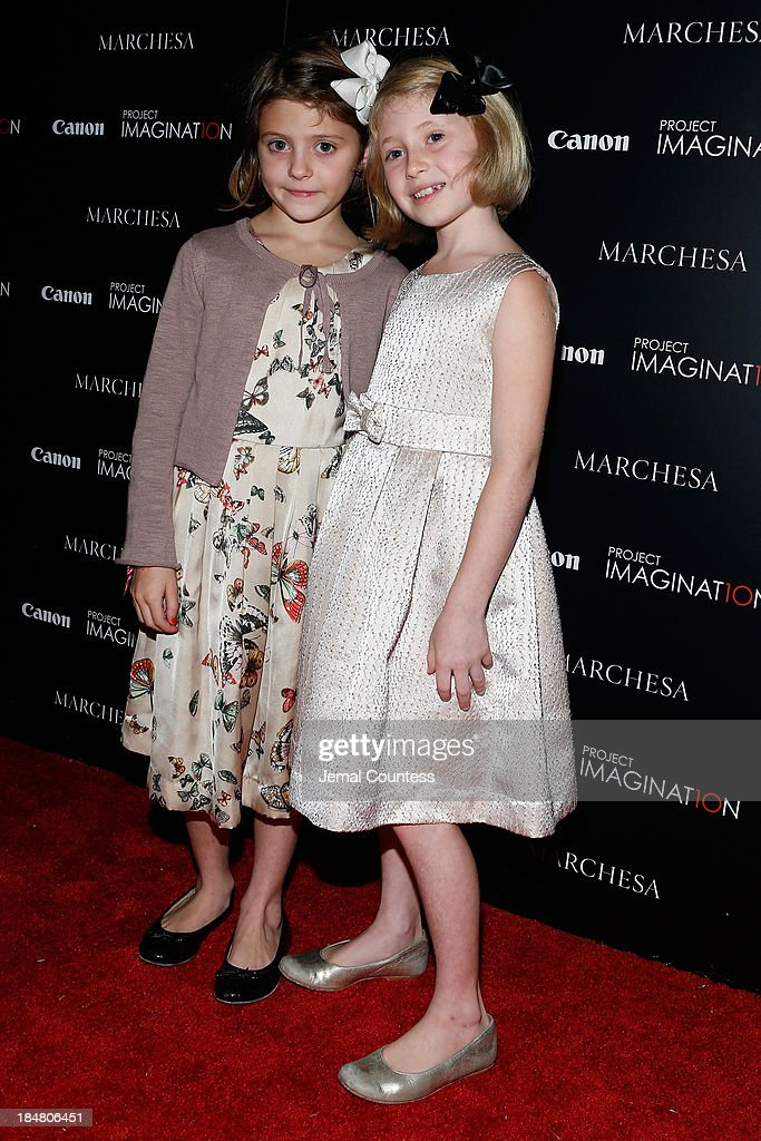 Actress Remy Bond (R) and Olivia Bond walk the carpet at Canon's Project Imaginat10n screening of 'A Dream of Flying,' a short film by Georgina Chapman at Crosby Street Hotel on October 16, 2013 in New York City.