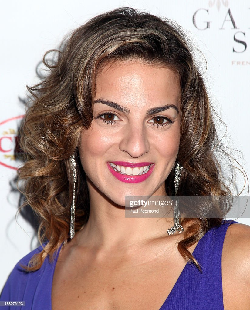 Actress Renee Marino attends Jane Seymour Art Exhibition Opening Benefiting Open Hearts Foundation at Gallerie Sparta on October 3, 2013 in West Hollywood, California.