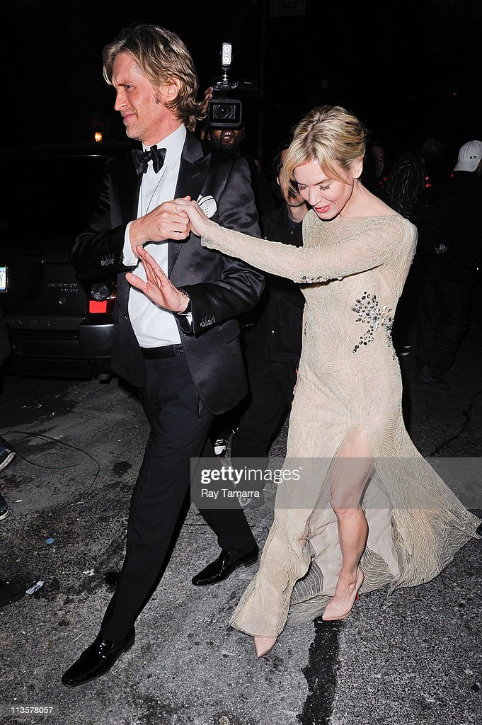 Actress Renee Zellweger (R) and guest enter the Crown Restaurant on May 2, 2011 in New York City.