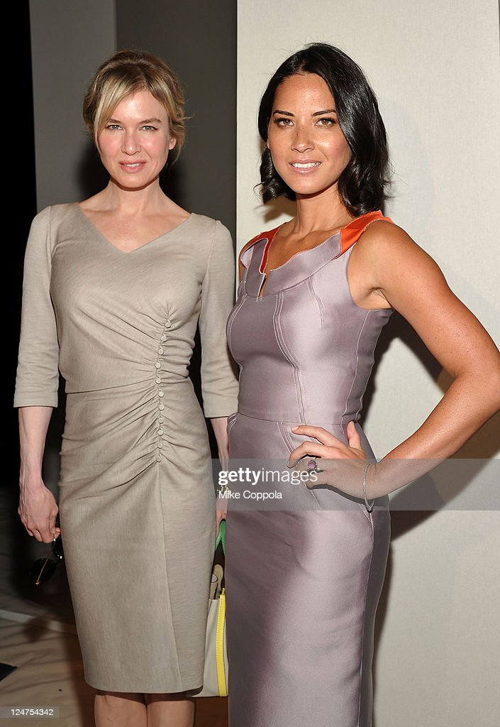 Actress Renee Zellweger and <a gi-track='captionPersonalityLinkClicked' href=/galleries/search?phrase=Olivia+Munn&family=editorial&specificpeople=598969 ng-click='$event.stopPropagation()'>Olivia Munn</a> attend the Carolina Herrera Spring 2012 fashion show during Mercedes-Benz Fashion Week at The Theater at Lincoln Center on September 12, 2011 in New York City.