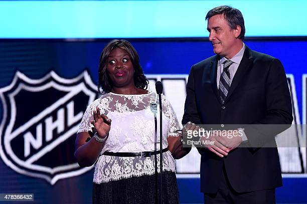 Actress Retta and Cam Neely speak onstage during the 2015 NHL Awards at MGM Grand Garden Arena on June 24 2015 in Las Vegas Nevada