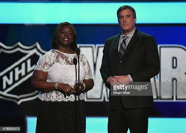 Actress Retta and former player Cam Neely present an award during the 2015 NHL Awards at MGM Grand Garden Arena on June 24 2015 in Las Vegas Nevada