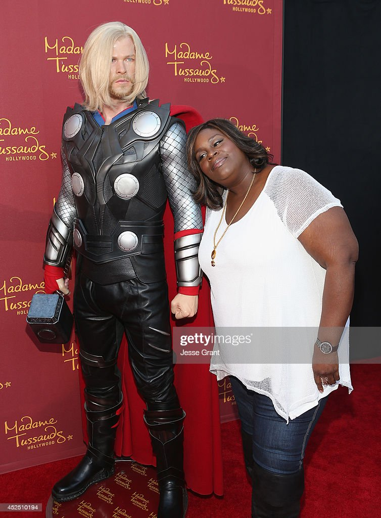 Actress Retta poses alongside a Madame Tussauds Hollywood MARVEL wax figure during the 'Guardians of The Galaxy' premiere at the Dolby Theatre on July 21, 2014 in Hollywood, California.