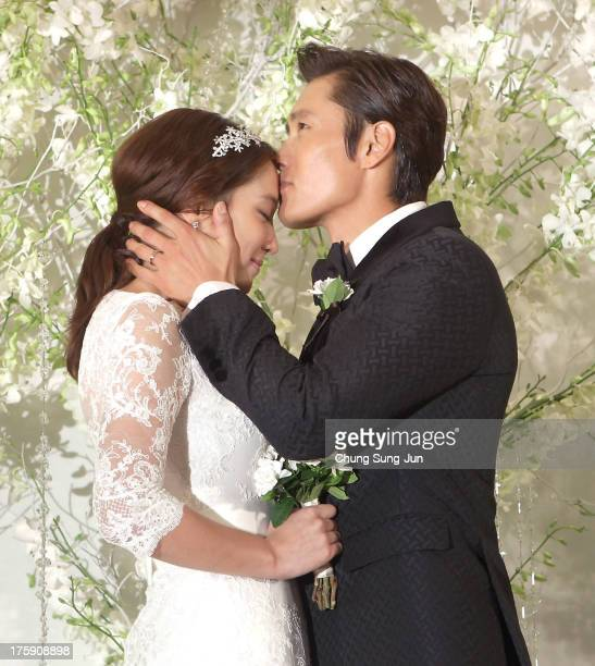 Actress Rhee MinJung and actor Lee ByungHun pose for photographs before their wedding at the Hyatt Hotel on August 10 2013 in Seoul South Korea