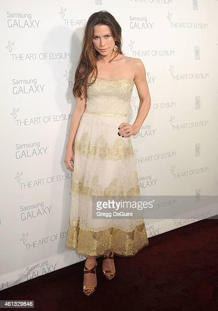 Actress Rhona Mitra arrives at The Art Of Elysium's 8th Annual Heaven Gala at Hangar 8 on January 10 2015 in Santa Monica California