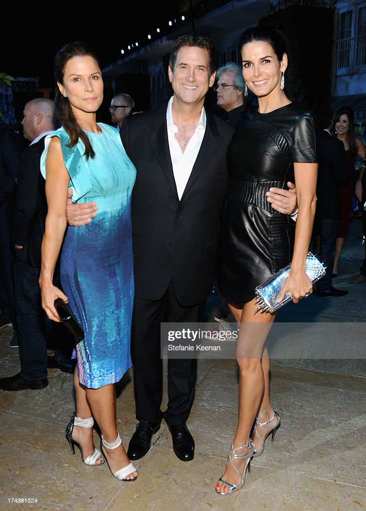 Actress Rhona Mitra, Michael Wright, President, Head of Programming TNT, TBS & TCM and Angie Harmon attend TNT 25TH Anniversary Party during Turner Broadcasting's 2013 TCA Summer Tour at The Beverly Hilton Hotel on July 24, 2013 in Beverly Hills, California.