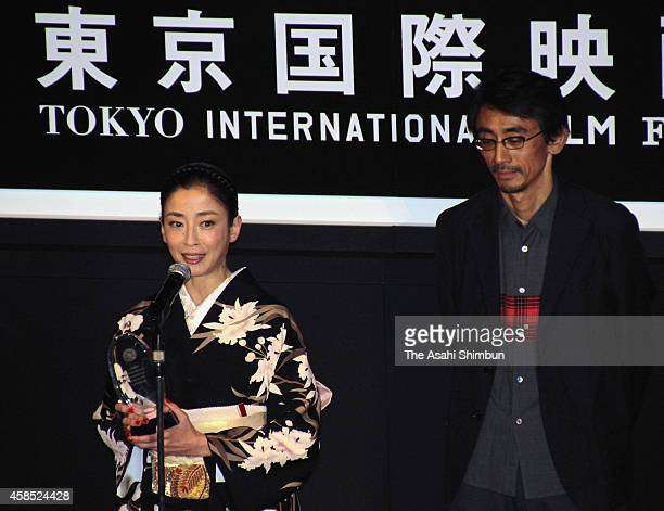 Actress Rie Miyazawa addresses after being awarded the best actress award at the closing ceremony of the Tokyo International Film Festival at...