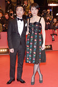 Actress Rinko Kikuchi and her husband actor Shota Sometani attends the 'Nobody Wants the Night' Opening Night premiere during the 65th Berlinale...