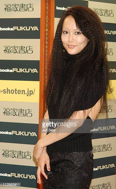 Actress Rinko Kikuchi attends her first photobook launch presscall at Fukuya bookstore on November 17 2007 in Tokyo Japan