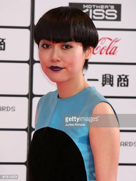 Actress Rinko Kikuchi poses for photographs on the red carpet during MTV Video Music Awards Japan 2008 at Saitama Super Arena on May 31 2008 in...