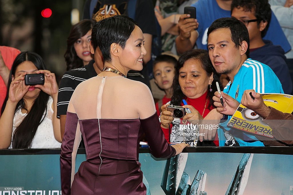 Actress Rinko Kikuchi poses with fans and signs autographs during the 'Pacific Rim (Titanes Del Pacifico)' Mexico City premiere at Reforma 222 on July 1, 2013 in Mexico City, Mexico.