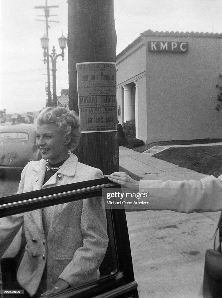 Actress Rita Hayworth enters her car on a street outside the KMPC studios in Beverly Hills, California.