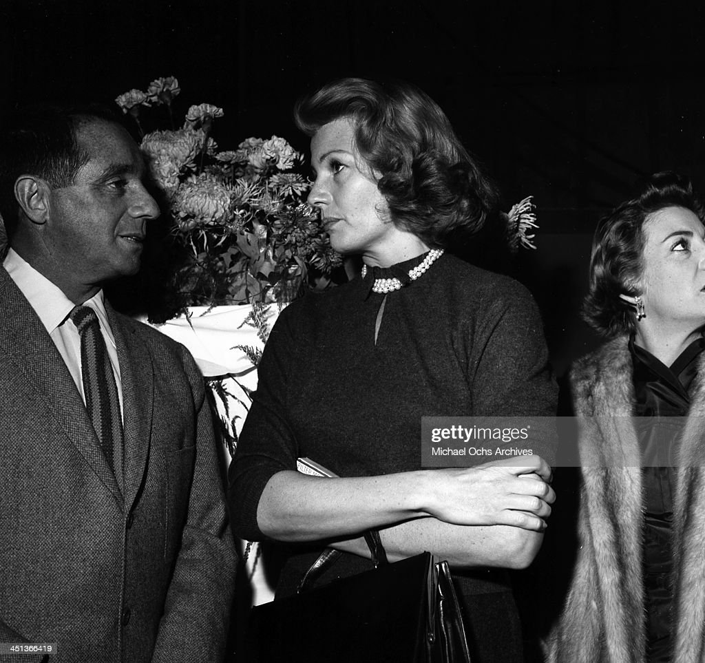 Actress Rita Hayworth talks with Jim Hill at a party in Los Angeles California