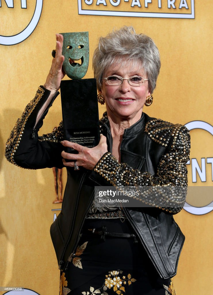 Actress <a gi-track='captionPersonalityLinkClicked' href=/galleries/search?phrase=Rita+Moreno&family=editorial&specificpeople=210549 ng-click='$event.stopPropagation()'>Rita Moreno</a> poses in the press room with the Screen Actors Guild Life Achievement Award at the 20th Annual Screen Actors Guild Awards at the Shrine Auditorium on January 18, 2014 in Los Angeles, California.