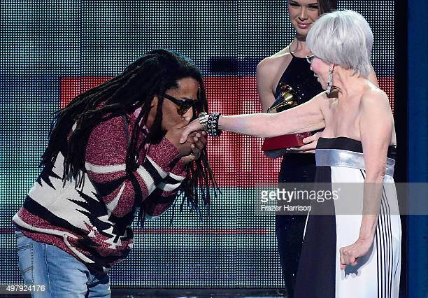 Actress Rita Moreno presents recording artist Tego Calderon the Best Urban Music Album award for 'El Que Sabe Sabe' onstage during the 16th Latin...